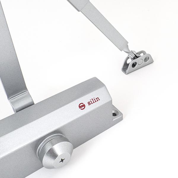Amortizor hidraulic cu brat reglabil, pentru usi de 15~150kg si  latime de pana la 1.5m, argintiu